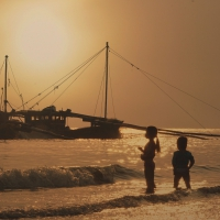 Schiebepuzzle mit dem Motiv Sonnenaufgang am Strand